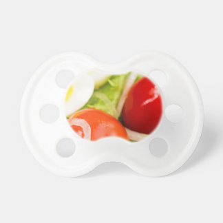 Blurred image of cherry tomatoes in a salad pacifier