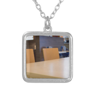 Blurred image of the interior cafe silver plated necklace