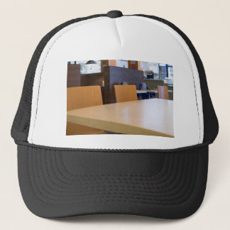 Blurred image of the interior cafe trucker hat