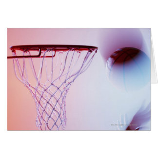 Blurred view of basketball going into hoop card
