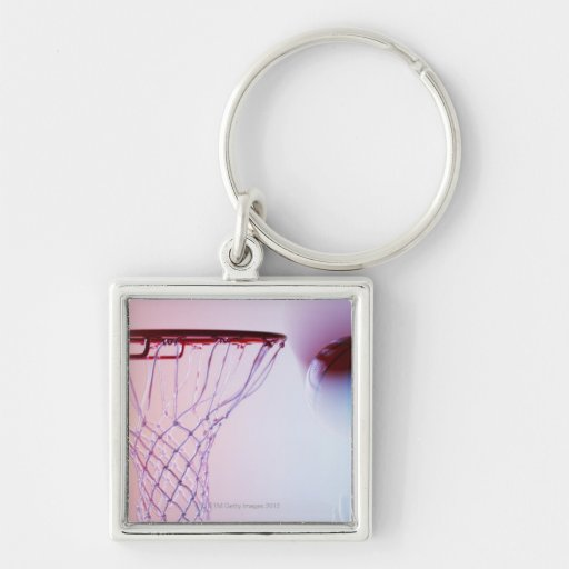 Blurred view of basketball going into hoop keychain