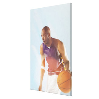 Blurred view of basketball player dribbling 2 stretched canvas print