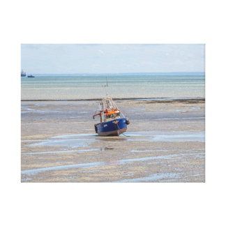 Boat at low tide canvas print