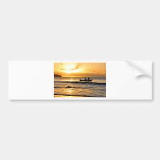 Boat at sunset bumper sticker