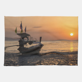 Boat at sunset on Pak Meng beach Kitchen Towel
