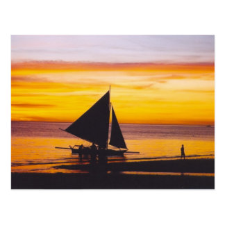 Boat at sunset postcard