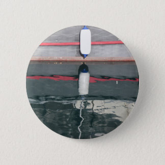 Boat fenders hanging on the board 2 inch round button