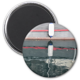 Boat fenders hanging on the board 2 inch round magnet