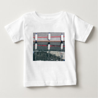 Boat fenders hanging on the board baby T-Shirt