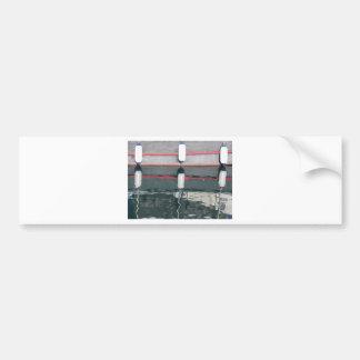 Boat fenders hanging on the board bumper sticker