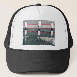 Boat fenders hanging on the board trucker hat
