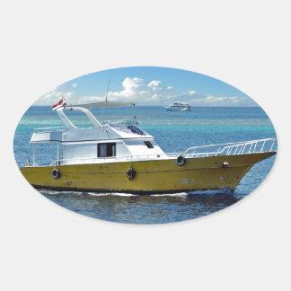 boat in the sea oval sticker