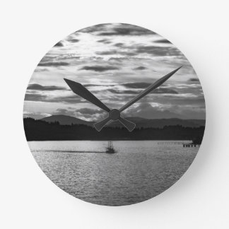 Boat on the water wall clocks