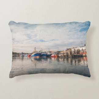 Boats docked between a clouds landscape accent pillow