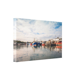 Boats docked between a clouds landscape canvas print