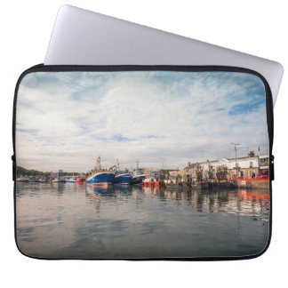 Boats docked between a clouds landscape laptop sleeve