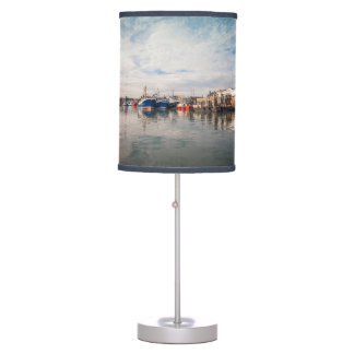 Boats docked between a clouds landscape table lamp