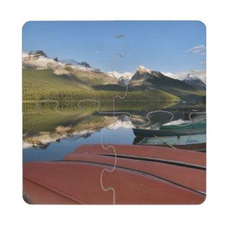Boats parked on the lakeshore of Maligne Lake, Puzzle Coaster
