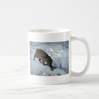 Bobcat on snow coffee mug