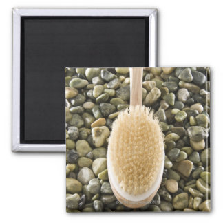 Body scrub brush on rocks square magnet