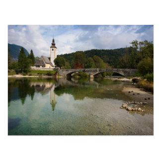 Bohinj lake with church in Slovenia postcard