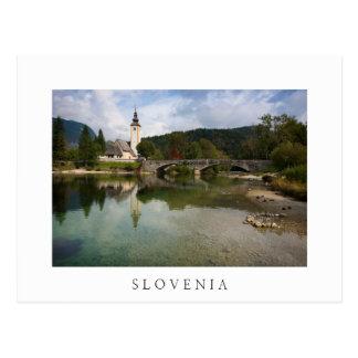 Bohinj lake with church in Slovenia white postcard