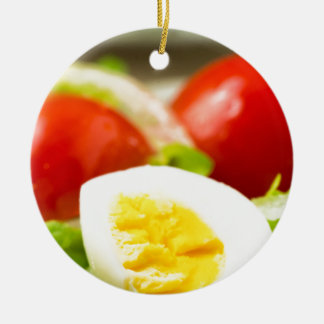 Boiled egg on a plate with lettuce, onions ceramic ornament