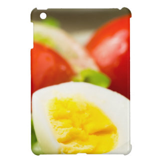 Boiled egg on a plate with lettuce, onions cover for the iPad mini