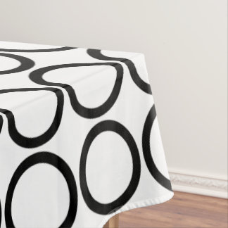 Bold Black Rings on White Tablecloth