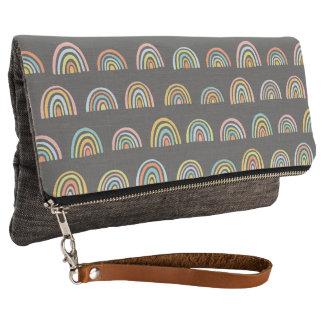 Bold modern geometric pattern in bright colors clutch