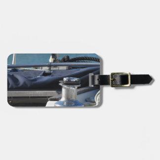 Bollard and mooring ropes on sailing boat bow luggage tag