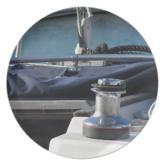Bollard and mooring ropes on sailing boat bow plate