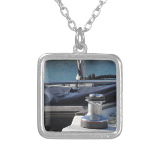 Bollard and mooring ropes on sailing boat bow silver plated necklace