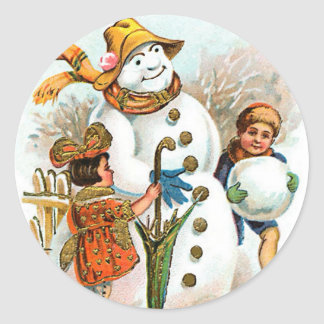 Bonhomme de neige vintage de village de Noël Autocollant Rond