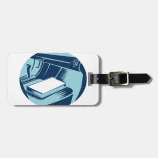 Book On Car Seat Oval Woodcut Bag Tag
