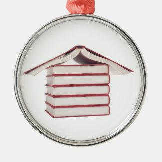 Books shaped like a house metal ornament