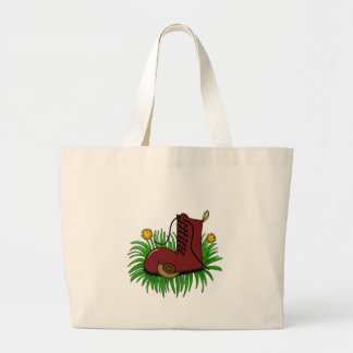 Boot in the grass large tote bag