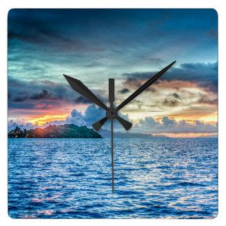 Bora Bora Sunset across the ocean Wall Clocks