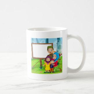 Border design with muslim family coffee mug