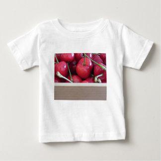 Border of fresh cherries on wooden background baby T-Shirt