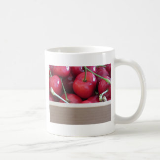 Border of fresh cherries on wooden background coffee mug