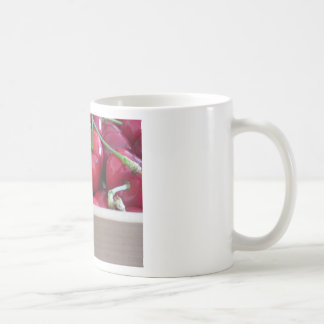 Border of fresh cherries on wooden background coffee mug