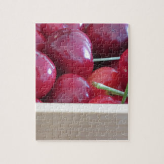Border of fresh cherries on wooden background jigsaw puzzle