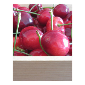 Border of fresh cherries on wooden background letterhead