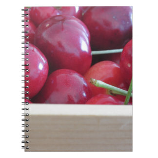 Border of fresh cherries on wooden background notebook