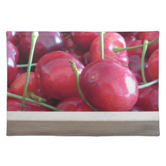 Border of fresh cherries on wooden background placemat