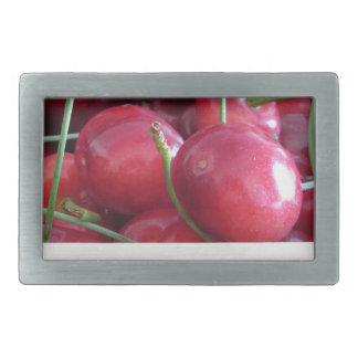 Border of fresh cherries on wooden background rectangular belt buckles