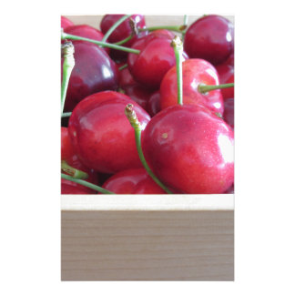 Border of fresh cherries on wooden background stationery