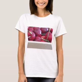 Border of fresh cherries on wooden background T-Shirt