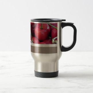 Border of fresh cherries on wooden background travel mug
